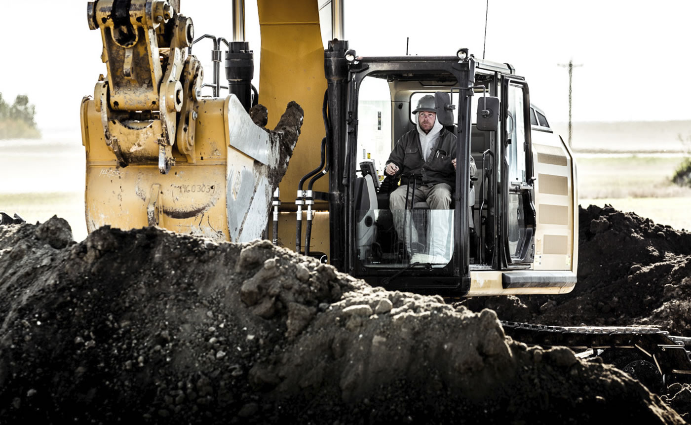 man operating heavy equipment backhoe