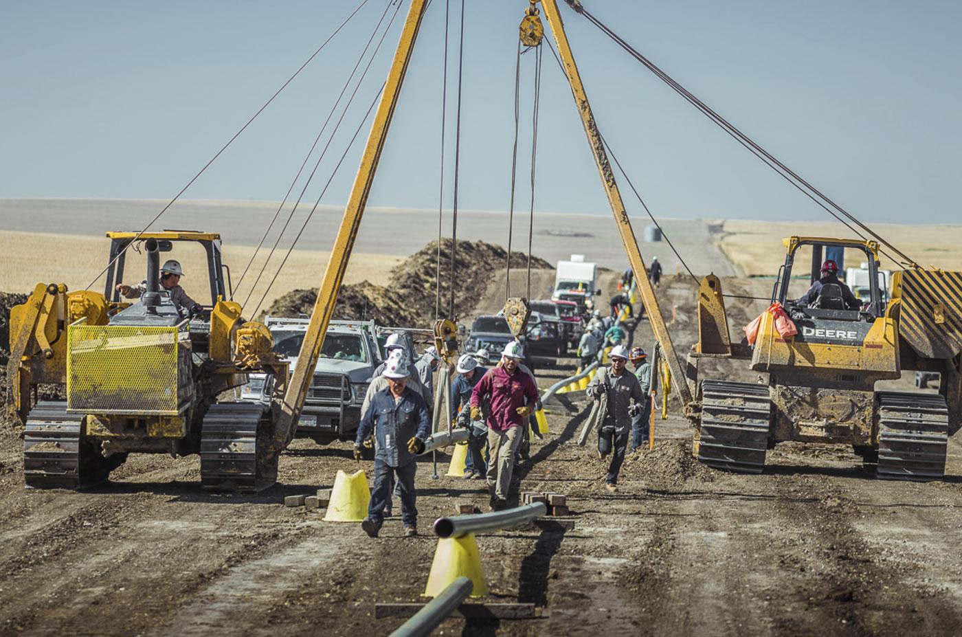 men working oilfield with equipment