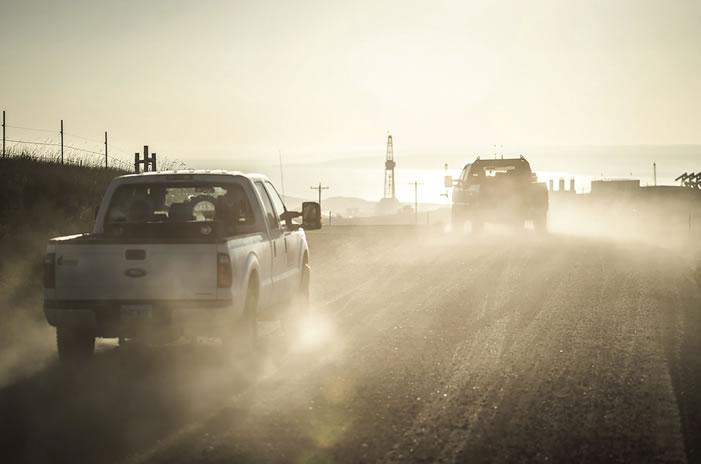 trucks driving on oil field site