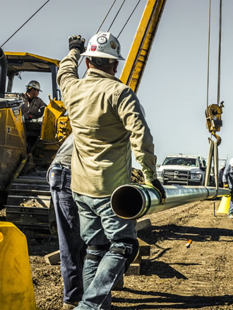 men working oilfield site