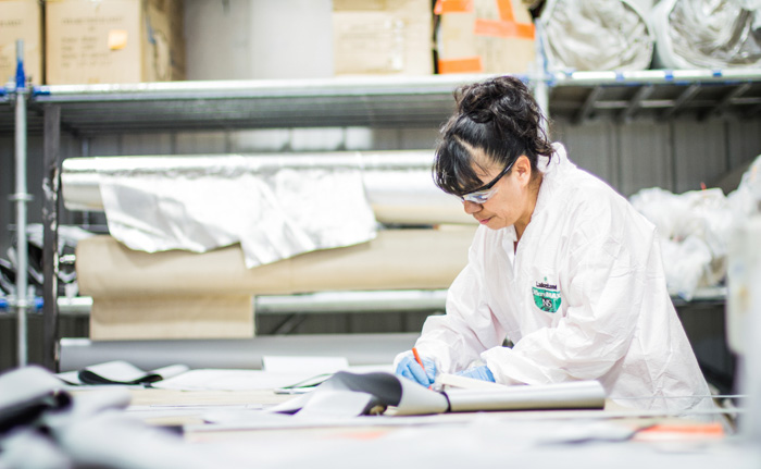 woman working with industrial fabrics