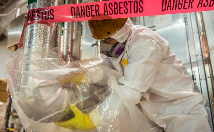 man removing asbestos
