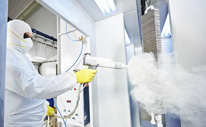 worker applying industrial coating