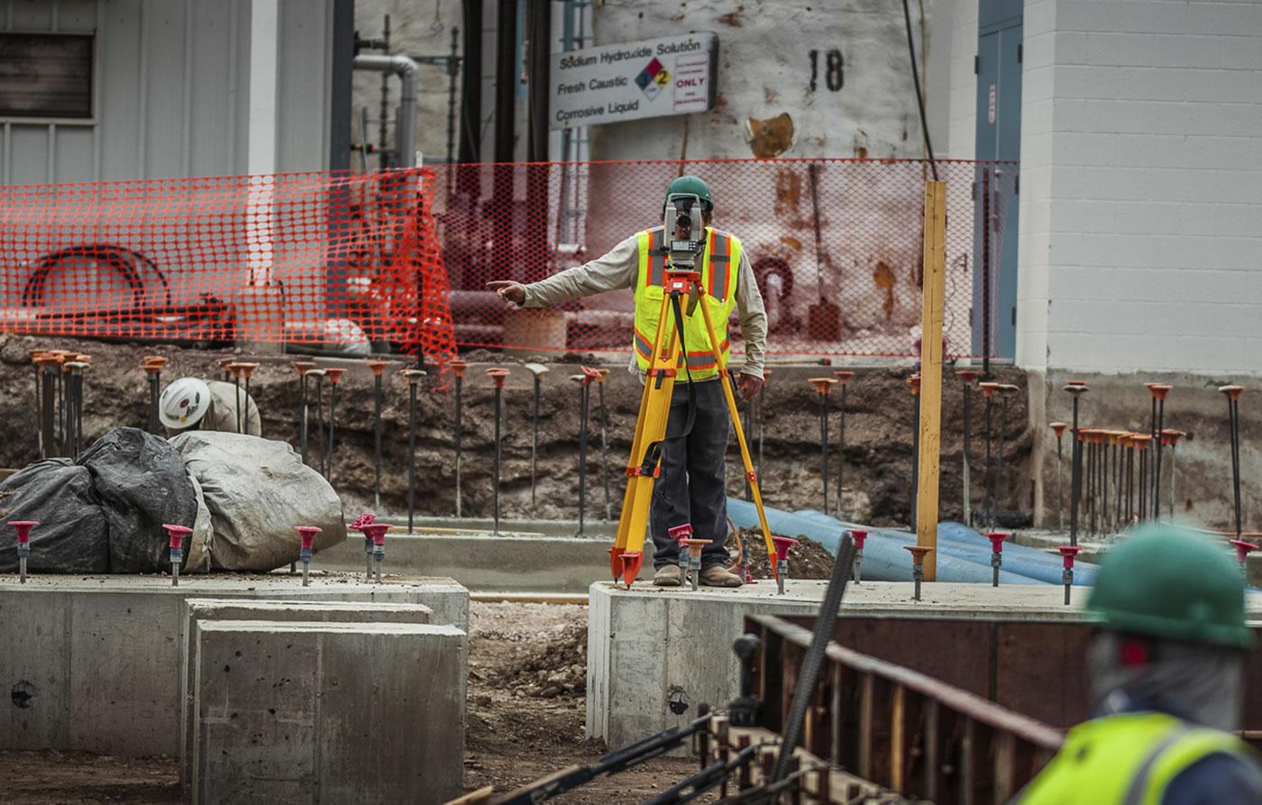 man surveying on site