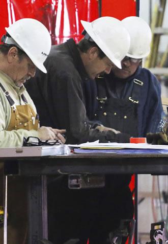 workmen reviewing plans