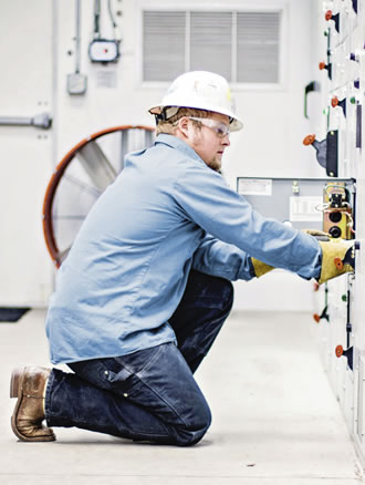 Man working inside with hard hat