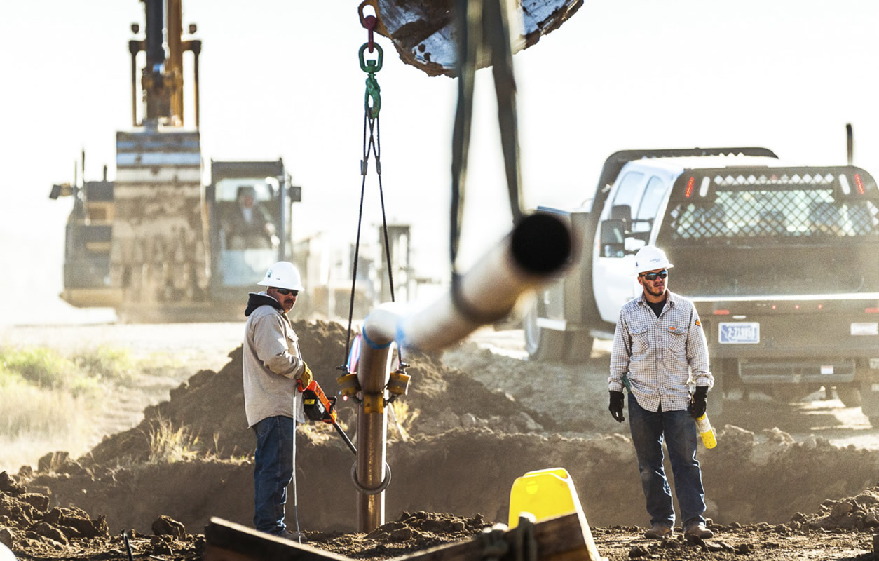Men working on pipeline