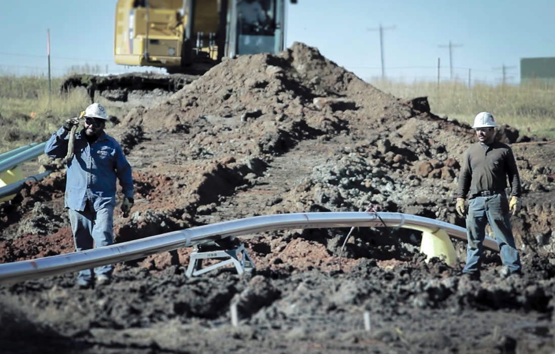 Men working on pipeline site